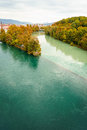 Autumn in geneva two rivers junction the rhone and the arve switzerland the river on the left is the rhone which is just Royalty Free Stock Photography