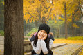 teenage girl with yellow leaves in autumn Royalty Free Stock Photo