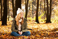 Autumn girl sitting in colorful leaves Royalty Free Stock Photography