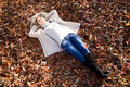 Autumn girl young woman lying in the grass Stock Photography