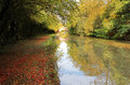 Autumn on the grand union canal at yelvertoft cover northamptonshire woods either side of are known locally as Royalty Free Stock Photos