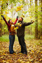 Autumn - Happy couple enjoying falling leaves Stock Photo