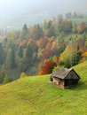 Autumn Hills With Old House