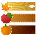 Autumn horizontal banners a collection of three autumnal with a orange leaf a red apple and a pumpkin on yellow and brown Royalty Free Stock Images