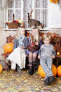 Autumn kids with pumpkin little boy and girls and leaves Royalty Free Stock Photo