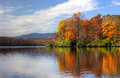 Autumn lake colorful leaves near a peaceful in Royalty Free Stock Photography
