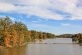 Autumn lake i shoreline in the with bridge Royalty Free Stock Photography