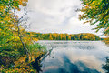 Autumn lake landscape with colorful trees Royalty Free Stock Photo