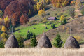 Autumn landscape with a haystacks in the mountains Royalty Free Stock Photo
