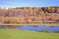 Autumn landscape with lake and forest Stock Photography