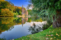 Autumn landscape with lake and old mansion Royalty Free Stock Photo