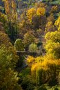 Autumn landscape old bridge over river in Royalty Free Stock Images