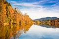 Autumn landscape scenery with yellow trees reflecting in lake Stock Photography