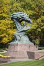 Autumn in lazienki park with monument of friderick chopin warsaw pianist poland Royalty Free Stock Photo