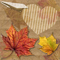 Autumn leaf with plane origami and heart romantic the letter from folded paper raster seasonal image Royalty Free Stock Photography