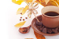 Autumn leaves and cup of coffee breakfast background beans chocolate with Royalty Free Stock Photos