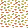 Autumn leaves fall red, green and yellow with an indentation on a white background simple seamless vector pattern.