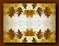 Autumn leaves frame on batik fabric Royalty Free Stock Photography