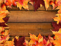 Autumn leaves frame on wood Stock Image