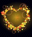 Autumn leaves in the heart frame over dark Royalty Free Stock Photo