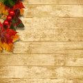 Autumn leaves over wooden background with copy space for text or photo Royalty Free Stock Images