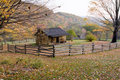 Autumn Log Cabin with Rail Fence Royalty Free Stock Photo