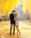 Autumn love relationships and people concept lovely couple in outdoors in sunny park Royalty Free Stock Photography