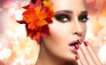 Autumn makeup and nail art trend fall beauty fashion girl professional manicure closeup portrait on autumnal background Stock Photos
