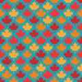 Autumn maple leaves symmetrical seamless pattern on blue background Royalty Free Stock Photo