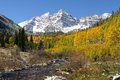 Autumn at maroon bells an morning after some overnight snowfall creek with freshly melted water running down from the side of Stock Image