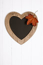 Autumn menu board with leaf hanging on white wall Royalty Free Stock Photography