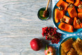 Autumn menu still ife roasted pumpkin with honey and walnuts fresh apples viburnum berries and honeycombs top view Royalty Free Stock Images