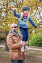 Autumn merry walk of the father and daughter Royalty Free Stock Photo