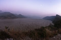 Autumn mist over Danube river at twilight with full moon over the river Royalty Free Stock Photo