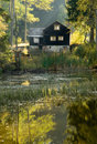 Autumn mood with hut on a lake Royalty Free Stock Photography