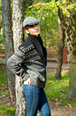 Autumn mood young woman in boyish clothing walking in the park over scenery Stock Images