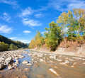 Autumn mountain stony river Royalty Free Stock Photo