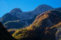 Autumn mountains above lake krn in october seen from lepena valley Stock Images