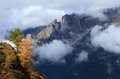 Autumn in the mountains colors and clouds italian alps Royalty Free Stock Images