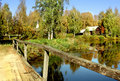 Autumn. Old bridge and houses in country Royalty Free Stock Photo