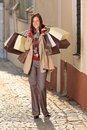 Autumn outfit shopping woman elegant with bags Royalty Free Stock Image