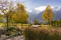 Autumn park overlooking the Austrian alps Royalty Free Stock Photo