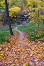 Autumn in the park path to waterfall golden Stock Photo