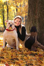 Autumn pet cute woman walking with dog Royalty Free Stock Image