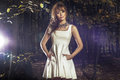 Autumn photo of beautiful woman fashion posing in white dress in forest Royalty Free Stock Image
