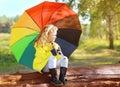 Autumn photo, little child with colorful umbrella