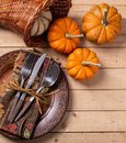 Autumn Place Setting on Wooden Table Royalty Free Stock Photo