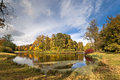 Autumn pond with yellow and red trees and bushes Stock Images