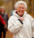 Autumn - Portrait of older woman zipping up jacket Stock Photo