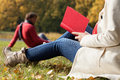 Autumn relax on fresh air couple spending freetime in by relaxing in the park Royalty Free Stock Photo